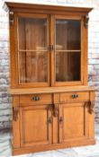 LATE VICTORIAN GOLDEN OAK BOOKCASE, ogee cornice and corbelled uprights, glazed door enclosing