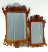 TWO GEORGIAN-STYLE MAHOGANY FRET MIRRORS, each with shaped cornice and corner flanges, 80cms and