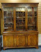 'REPRODUX' MAHOGANY BOOKCASE, arcaded dentil cornice, astragal doors, adjustable shelves, cupboard
