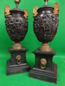 PAIR OF GILT METAL & BRONZE TWIN-HANDLED URNS of amphora shape in the Greek style with a band of