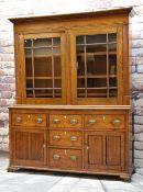 19TH CENTURY OAK GLAZED DRESSER, shallow cornice, square astragal glazed doors, fixed shelves, on