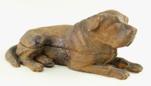 BLACK FOREST CARVED INKSTAND, in the form of a recumbent mastiff hound, hinged lid opening to reveal