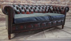 MAROON LEATHER CHESTERFIELD SOFA, with grey cloth over cushion, stained turned beech legs, 183 x