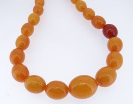 STRING OF GRADUATED OVAL BUTTERSCOTCH BEADS, 88cms long approx, 75gms approx