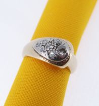 YELLOW & WHITE METAL SEVEN-STONE DIAMOND RING of teardrop design, ring size N, 7.3gms