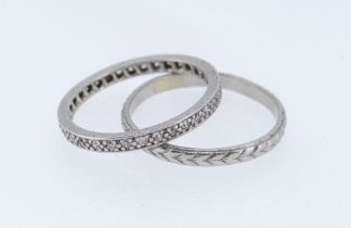 TWO PLATINUM RINGS comprising wedding band of arrow head design together with platinum and diamond