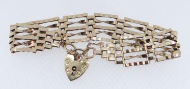 9CT GOLD FIVE-BAR GATE BRACELET, heart shaped padlock, 11.8gms