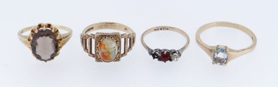 FOUR GOLD GEM SET RINGS comprising three 9ct gold rings and a 14ct gold ring, 11.1gms overall (4)