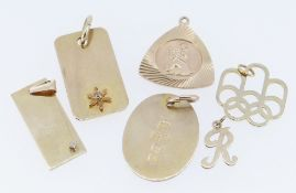 ASSORTED PENDANTS comprising five 9ct gold pendant, two set with tiny diamonds, together with a