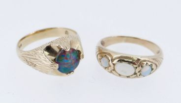 TWO 9CT GOLD OPAL RINGS comprising one set with single black opal triplet (size T) together with