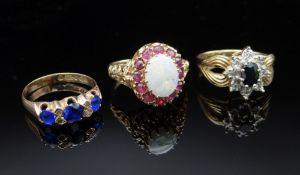 THREE 9CT GOLD RINGS comprising sapphire & diamond chip ring (size O), opal & ruby ring (size M),