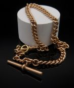 9CT GOLD ALBERT WATCH CHAIN, curb link with T-bar, 36.5cms long, 39.9gms