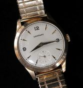 9CT GOLD GARRARD GENTS WRISTWATCH, the dial with pointed batons and Arabic numerals at 3, 9 and 12