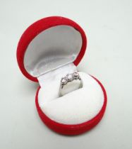 18CT WHITE GOLD THREE-STONE DIAMOND RING, the three stones totalling 0.6cts approx. (visual