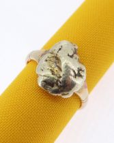 YELLOW METAL NUGGET set on 18ct gold shank, ring size O, 5.6gms - family belief is that the nugget