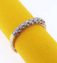 18CT GOLD EIGHT-STONE DIAMOND RING, in half eternity design, 0.22cts overall approx., ring size R,