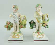 A RARE PAIR OF SWANSEA CAMBRIAN POTTERY PUTTI in the form of swag wearing flower pickers and their