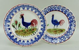 TWO CIRCULAR LLANELLY POTTERY COCKEREL PLATES, blue border and the cockerels blue with red tails,