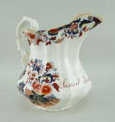A LLANELLY SOUTH WALES POTTERY NAMED JUG of fluted form with twig handle, in transfer decorated in