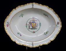 ARMORIAL DISH ATTRIBUTED TO SWANSEA EARTHENWARE with feathered edge and centred coat of arms in