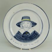 A LLANELLY POTTERY PLATE WITH PORTRAIT OF A PURITAN with amusing grammar mistake, painted in blue