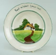 A RARE LLANELLY POTTERY COTTAGE DECORATED PLATE with inscription to border 'East or West homes