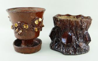 TWO BUCKLEY POTTERY PLANTERS the principle of pedestal form over drip-dish, both in brown glaze