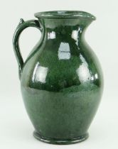 EWENNY POTTERY LARGE JUG in mottled deep green glaze, handle with spur, base inscribed Claypits