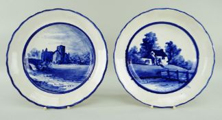 A PAIR OF LLANELLY POTTERY PLATES painted in underglaze blue with a church or abbey and with a