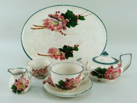 A LLANELLY POTTERY FIVE-PIECE CABARET SET comprising oval tray, teapot, cream-jug, sugar basin and