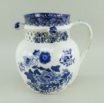 A SWANSEA CAMBRIAN PUZZLE JUG circa 1810, ovoid shape and loop handle, with cylindrical neck pierced