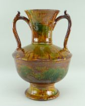 EWENNY POTTERY LARGE TWIN-HANDLED AMPHORA SHAPED VASE in mottled green and brown glaze, bulbous