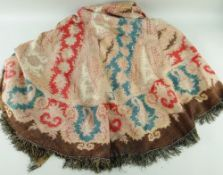 A VERY LARGE BELIEVED 19TH CENTURY WELSH PAISLEY SHAWL, of arched form with fine fringe, 310 x