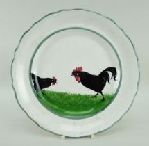 A LLANELLY POTTERY COCK & HEN DECORATED PLATE the birds pecking on grass and within green continuous