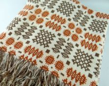 AN ANTIQUE TRADITIONAL WELSH BLANKET, in mustard ground with repeat bands of iron red and brown