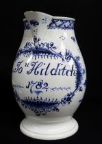 A SWANSEA POTTERY BALUSTER JUG NAMED & DATED 1782 of baluster footed form with loop handle,