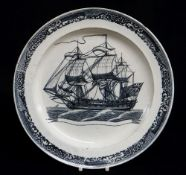 A CAMBRIAN SWANSEA PEARLWARE SHIP PLATE circa 1800, transfer decorated in ink-blue with a brig in