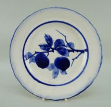 LLANELLY POTTERY PLATE painted in underglaze blue with a fruiting branch, within blue line border,