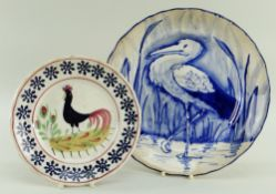 A LLANELLY POTTERY PLATE PAINTED IN BLUE WITH STORK IN REEDS of lobed form, 25cms diam, together
