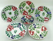 SIX LLANELLY POTTERY 'PERSIAN ROSE' PATTERN PLATES, 4 x 25cms diam, 1 x 27cms diam, 1 x 20cms (bowl)