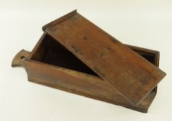 19TH CENTURY OAK CANDLE BOX with sliding cover and hanging handle, 46cms high Provenance: private