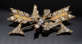 VICTORIAN DIAMOND ENCRUSTED DOVE & CROSSED ARROWS BROOCH, yellow metal, the dove set with ruby eyes,