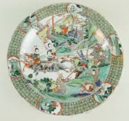 CHINESE FAMILLE VERTE 'FEMALE RECRUITS' PORCELAIN DISH, Kangxi, centre decorated with three