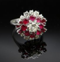 18CT WHITE GOLD DIAMOND & RUBY CLUSTER RING, the central stone 0.3cts approx. (visual estimate),