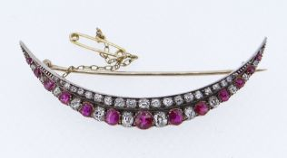 FINE DIAMOND & RUBY ENCRUSTED CRESCENT BROOCH, the forty-eight graduated stones set in yellow and