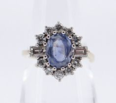 18CT GOLD SAPPHIRE & DIAMOND CLUSTER RING, the central oval sapphire 8 x 6 mm surrounded by ten