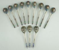TWO SETS RUSSIAN ENAMEL & SILVER GILT TEASPOONS, 1908-1917, one a set of nine with makers mark 'EO',