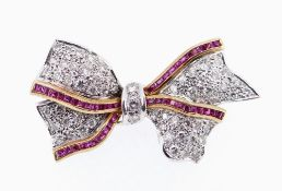 18CT WHITE GOLD DIAMOND & RUBY BAR BROOCH, of bow design with border of rubies, 4.2cms wide, 11.