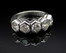 18CT WHITE GOLD FIVE STONE DIAMOND RING, in geometric setting, the five diamonds totalling 0.75cts
