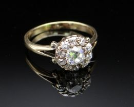 YELLOW METAL DIAMOND CLUSTER RING, the central stone 0.4cts approx. (visual estimate), surrounded by